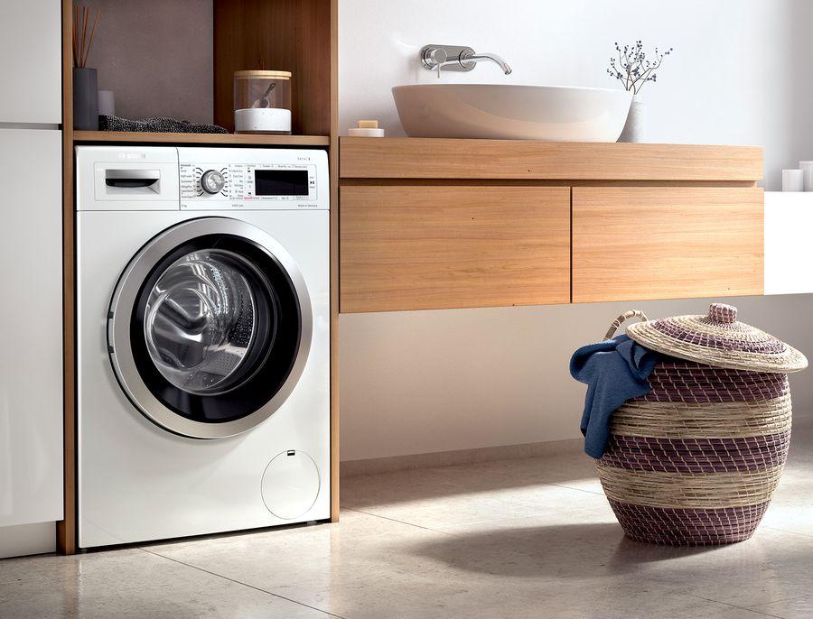 lavadora en cuarto de lavado